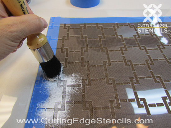 DIY stenciled placemat with stencil brush