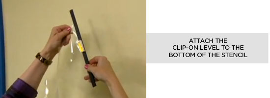 Attach the clip-on level to the bottom of the stencil