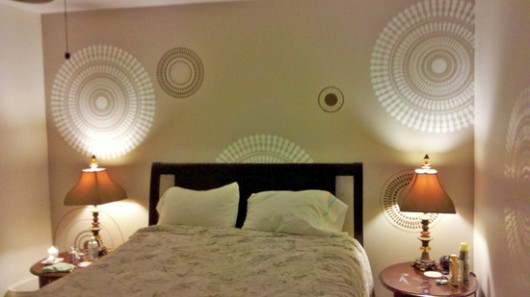 Add a fun wall stencil like the Funky Wheel Design to a neutral colored bedroom!