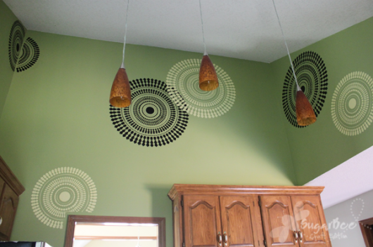 Awesome kitchen renovation using the Funky Wheel design above the kitchen cabinets.