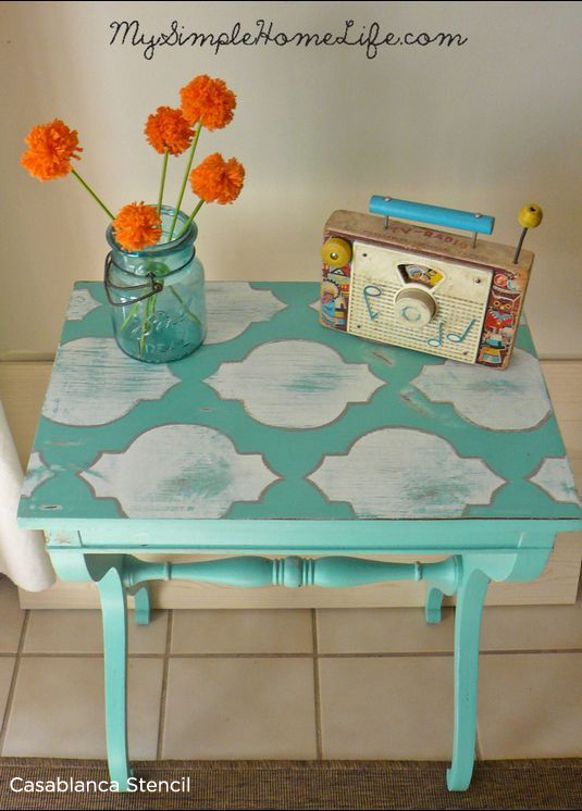 Adorable stenciled turquoise table using the Casablanca Stencil from Cutting Edge Stencil.