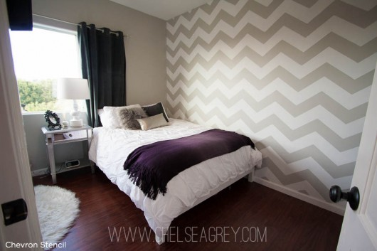 Love this! Beautiful chevron stenciled bedroom idea. The chevron striped pattern makes the accent wall pop.