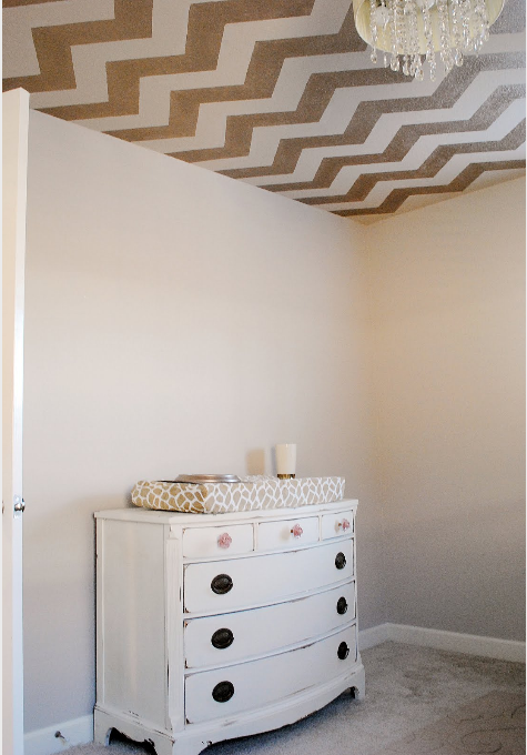 Use the Chevron Stencil from Cutting Edge Stencils in Modern Mettalic Gold to get this look!   http://www.cuttingedgestencils.com/chevron-stencil-pattern.html