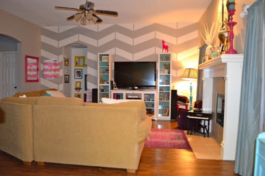 Use the Herringbone Stencil from Cutting Edge Stencils to get a similar look. http://www.cuttingedgestencils.com/herringbone-stencil-pattern.html