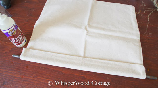 Grab your fabric adhesive. Apply generously along the edge of the pillow case. Fold the edge over the rod and press the fabric together. Give it adequate time to dry per instructions on the bottle.