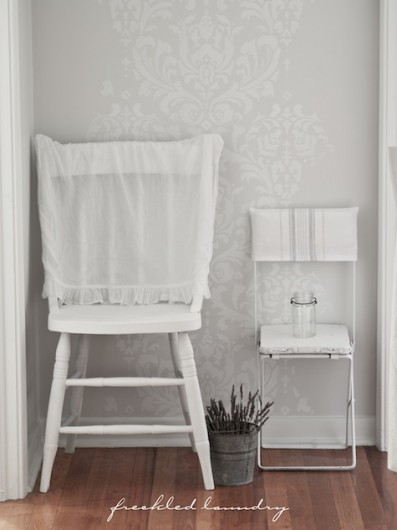 A white stenciled hallway using the Anna Damask wall pattern from Cutting Edge Stencils. http://www.cuttingedgestencils.com/damask-stencil.html