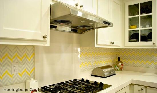 A Herringbone craft stenciled kitchen backsplash in gray and yellow. http://www.cuttingedgestencils.com/craft-stencil-herringbone.html