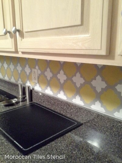 A stenciled kitchen backsplash using the Moroccan Tiles pattern from Cutting Edge Stencils.  & Spice Up Your Kitchen Backsplash With A Stencil