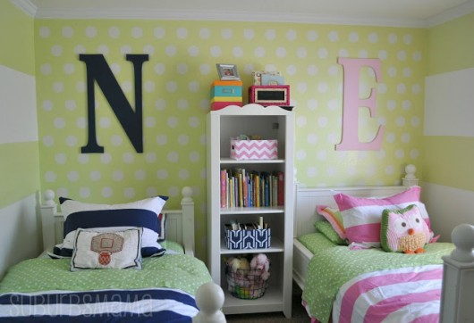 A green stenciled kids bedroom using the Polka Dot Allover pattern from Cutting Edge Stencils. http://www.cuttingedgestencils.com/polka-dots-stencils-nursery.html