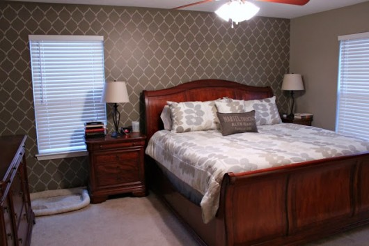 An Hourglass Allover stenciled brown accent wall in a bedroom.  http://www.cuttingedgestencils.com/modern-stencil.html