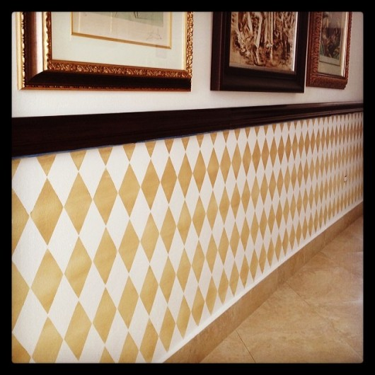 A gold stenciled accent wall using the Harlequin Allover pattern. http://www.cuttingedgestencils.com/harlequin-stencil-pattern.html