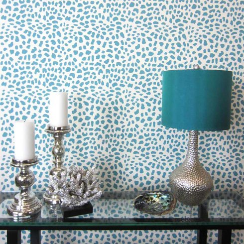 A blue Leopard Skin Allover stenciled accent wall. http://www.cuttingedgestencils.com/leopard-pattern-animal-skin-stencil.html