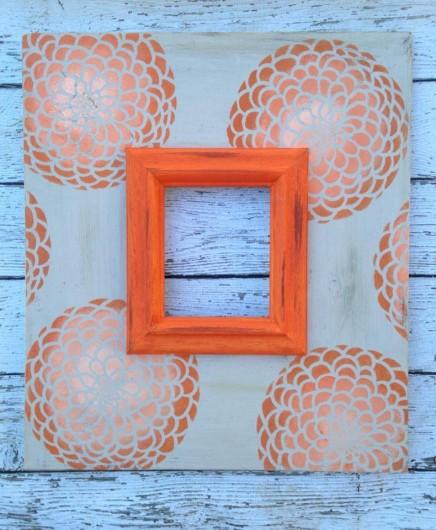An orange ombre stenciled frame using the Zinnia Grande Stencil. http://www.cuttingedgestencils.com/flower-stencil-zinnia-wall.html