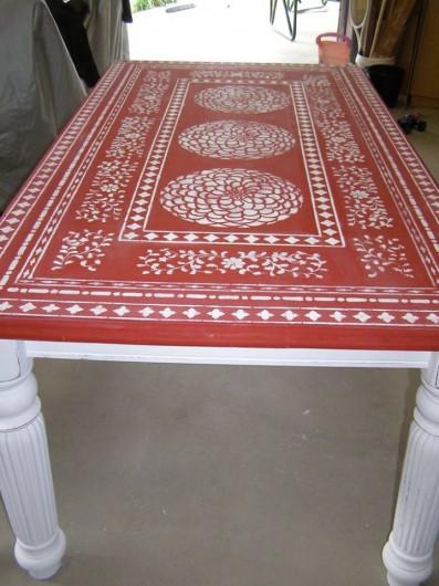A red stenciled table using the Zinnia Grande Stencil and Indian Inlay Stencil kit. http://www.cuttingedgestencils.com/flower-stencil-zinnia-wall.html