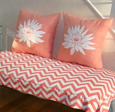 A DIY coral stenciled accent pillow using the Lotus Grande Flower Stencil. http://www.cuttingedgestencils.com/lotus-flower-stencil.html