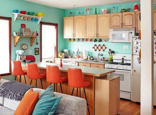 A turquoise and tangerine kitchen spotted on Apartment Therapy. http://www.pinterest.com/pin/288160076132091183/