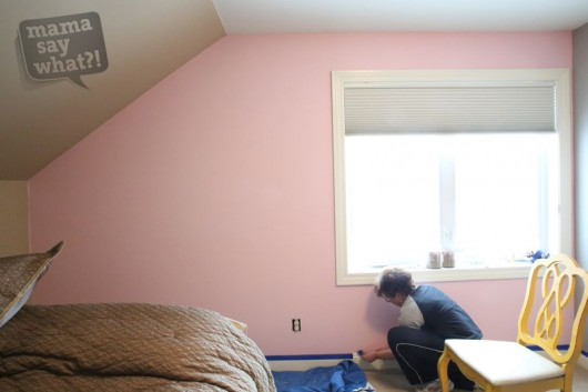 A before shot of a pink and teal stenciled accent wall in a nursery. http://www.cuttingedgestencils.com/damask-stencil-3.html