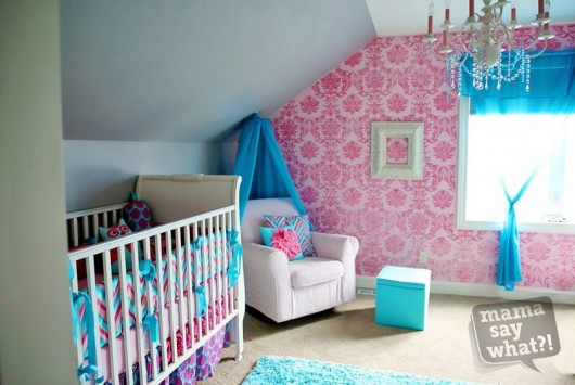 A pink and teal nursery with a Gabrielle Damask stenciled accent wall. http://www.cuttingedgestencils.com/damask-stencil-3.html