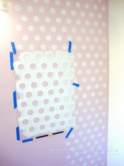A DIY stenciled accent wall in a pink nursery using the Polka Dot Allover Stencil. http://www.cuttingedgestencils.com/polka-dots-stencils-nursery.html
