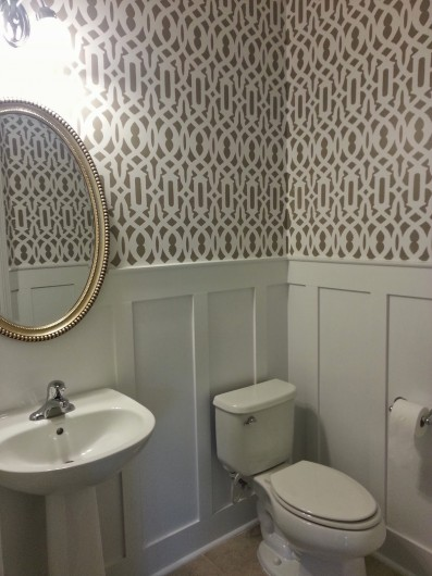 A DIY stenciled bathroom featuring the Trellis Allover pattern for a wallpaper look. http://www.cuttingedgestencils.com/allover-stencil.html