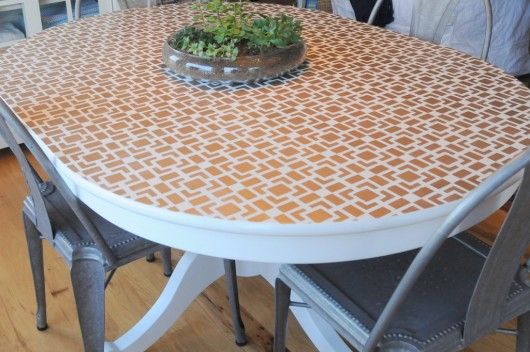 A DIY stenciled table using the Outside of the Box craft stencil in gold. http://www.cuttingedgestencils.com/geometric-small-stencil.html