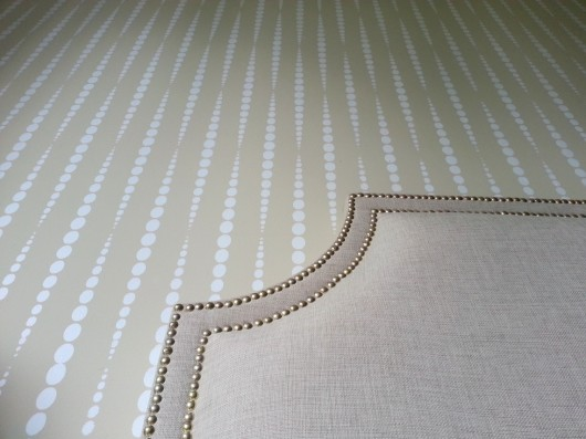 A beige DIY stenciled bedroom feature wall using the Beads Allover stencil pattern. http://www.cuttingedgestencils.com/beads-wall-stencil-pattern.html