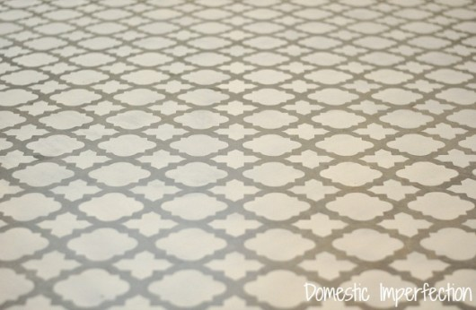 A DIY stenciled cement floor in a laundry room using the Moroccan Tiles pattern. http://www.cuttingedgestencils.com/moroccan-tiles-wall-pattern.html