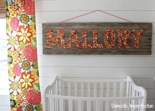 Reclaimed wood art using buttons. http://www.domesticimperfection.com/2014/08/nursery-sign-semi-fail/