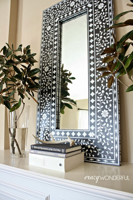 A DIY stenciled mirror using the Indian Inlay stencil pattern. http://www.cuttingedgestencils.com/indian-inlay-stencil-furniture.html