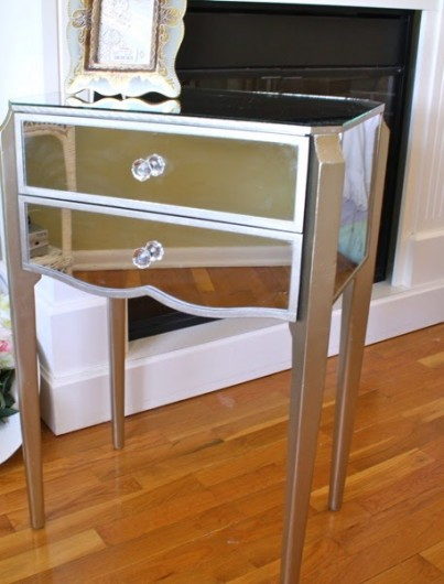 A mirrored side table in a Hollywood Glam bedroom makeover.