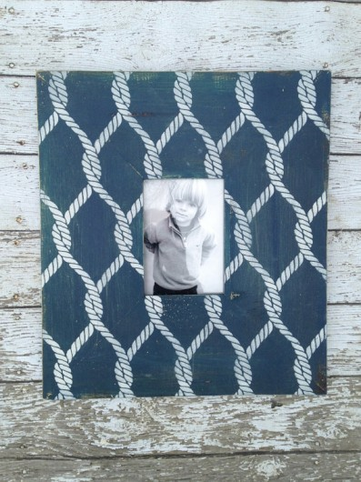 A DIY stenciled wooden frame using the Perfect Catch craft stencil in indigo blue. https://www.etsy.com/listing/181754180/nautical-rope-wood-picture-frame-for?ref=shop_home_active_6