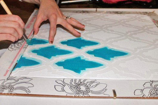 Stenciling the Oasis Paint-A-Pillow kit in turquoise. http://paintapillow.com/index.php/oasis-paint-a-pillow-kit.html