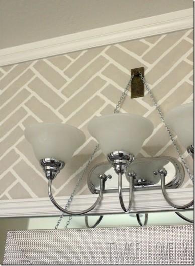 A DIY stenciled accent wall in a bathroom using the Herringbone Brick Allover. http://www.cuttingedgestencils.com/herringbone-brick-pattern-stencil-wall-decor.html