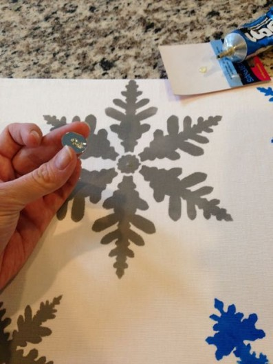Adding rhinestones to the DIY Snowflakes Paint-A-Pillow kit. http://paintapillow.com/index.php/snowflakes-paint-a-pillow-kit.html