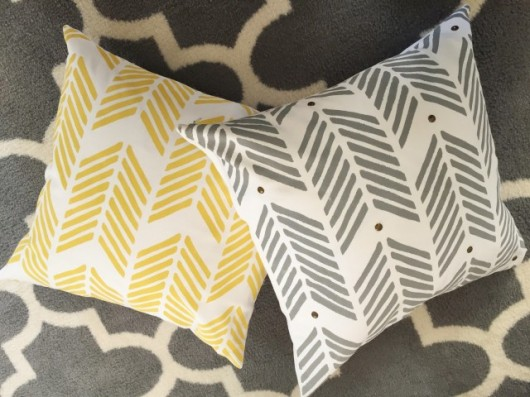 DIY painted and stenciled accent pillows using the Drifting Arrows Paint-A-Pillow kit. http://paintapillow.com/index.php/drifting-arrows-paint-a-pillow-kit.html