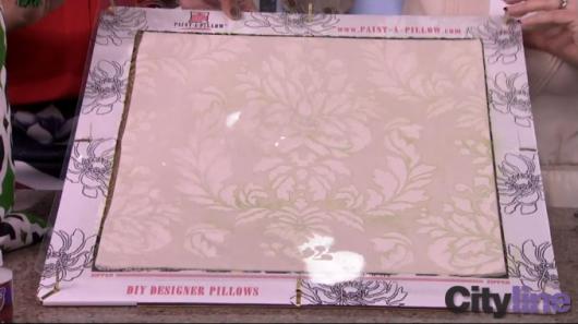 Stenciling a Verde Damask Paint-A-Pillow kit on Cityline. http://paintapillow.com/index.php/verde-damask-paint-a-pillow-kit.html