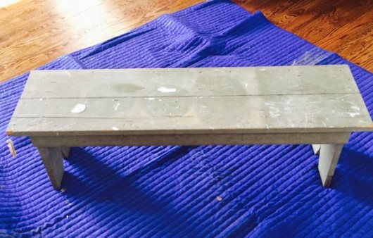 An old wooden bench before its stenciled makeover.
