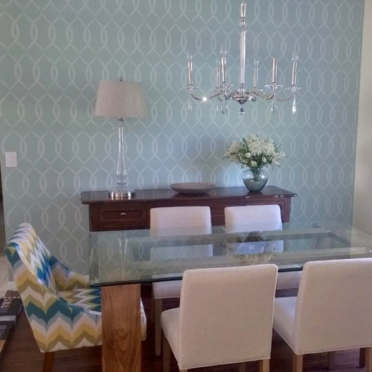 A blue DIY stenciled accent wall in a dining room using the Entwined Allover Stencil. http://www.cuttingedgestencils.com/stencil-pattern-2.html