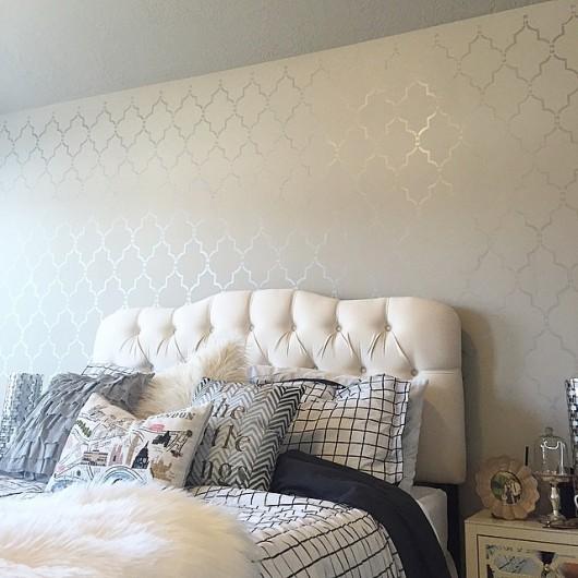 A white and silver DIY stenciled bedroom accent wall using the Marrakech Trellis Allover Stencil. http://www.cuttingedgestencils.com/moroccan-stencil-marrakech.html