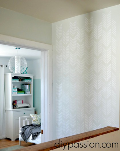 A DIY white stenciled hallway makeover using the Drifting Arrows Allover stencil. http://www.cuttingedgestencils.com/drifting-arrows-stencil-pattern-diy-decor.html