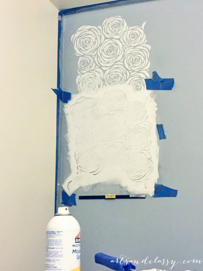 Stenciling a DIY kitchen accent wall using the Roses Allover Stencil in gray. http://www.cuttingedgestencils.com/roses-stencil-pattern-rose-design.html