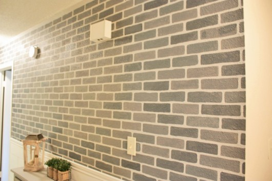 A DIY stenciled accent wall using the Brick Allover Stencil pattern in gray. http://www.cuttingedgestencils.com/bricks-stencil-allover-pattern-stencils.html