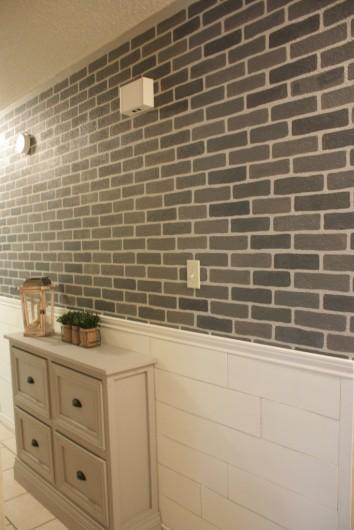 Cutting Edge Stencils shares a DIY stenciled hallway accent wall using the Brick Allover Stencil in gray colors. http://www.cuttingedgestencils.com/bricks-stencil-allover-pattern-stencils.html
