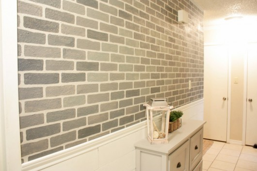A DIY stenciled hallway using the Brick Allover Stencil pattern in gray. http://www.cuttingedgestencils.com/bricks-stencil-allover-pattern-stencils.html