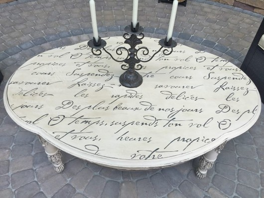 A DIY stenciled outdoor table using the French Poem Allover Stencil. http://www.cuttingedgestencils.com/french-poem-typography-letter-stencil.html