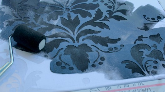 Painting a DIY stenciled outdoor accent pillow using the Wild Berry Damask Paint-A-Pillow kit. http://paintapillow.com/index.php/wild-berry-damask-paint-a-pillow-kit.html