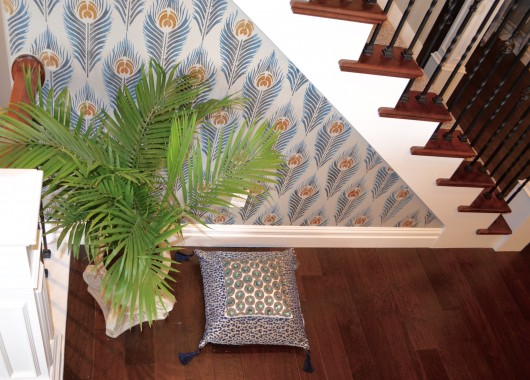 A DIY stenciled accent wall using the Peacock Feather Allover Stencil. Stenciling the Peacock Feather allover stencil pattern on an accent wall. http://www.cuttingedgestencils.com/peacock-feather-wall-stencil-pattern.html