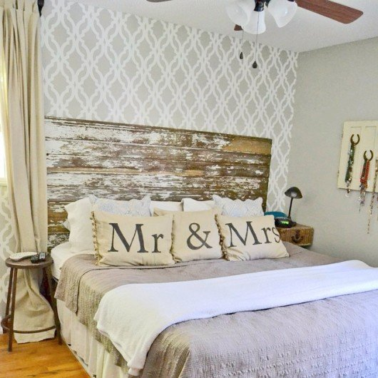 A gray and white DIY stenciled accent wall in a bedroom using the Tamara Trellis Allover pattern. http://www.cuttingedgestencils.com/tamara-trellis-allover-wall-stencils.html