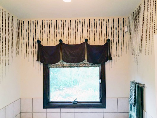 A DIY stenciled bathroom wall with an ombre effect using the Beads Allover Stencil. http://www.cuttingedgestencils.com/beads-wall-stencil-pattern.html