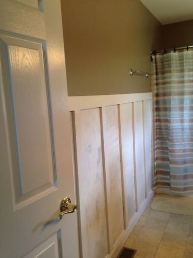 DIY board and batten for a stenciled bathroom makeover. http://www.cuttingedgestencils.com/sophia-trellis-stencil-geometric-wall-pattern.html